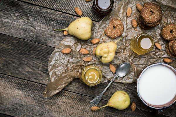Pears Cookies Almonds and milk on wood Stock photo © Arsgera
