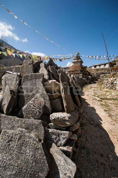 Mani stones and Buddhist stupe or chorten in Himalayas Stock photo © Arsgera