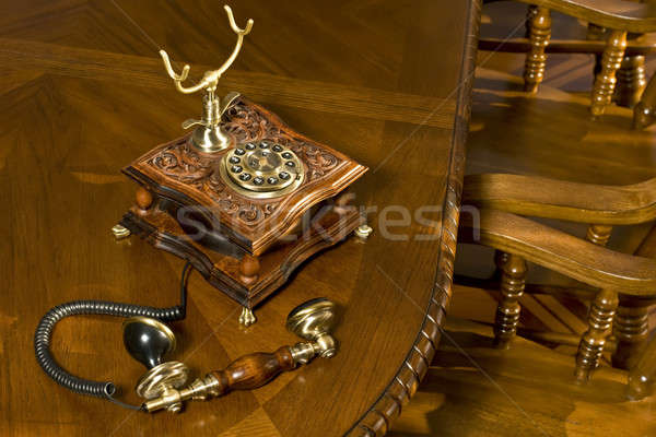 Old-fashioned telephone on table Stock photo © Arsgera