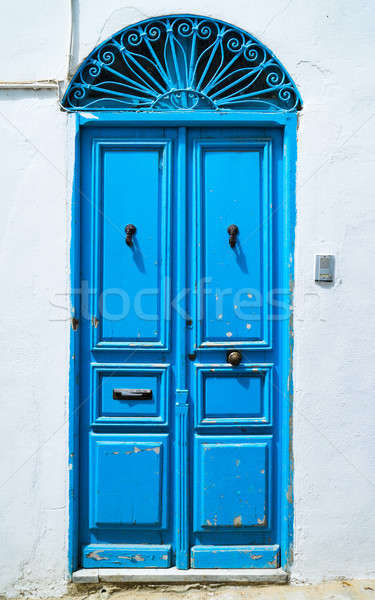 Aged Blue door in Andalusian style from Sidi Bou Said Stock photo © Arsgera