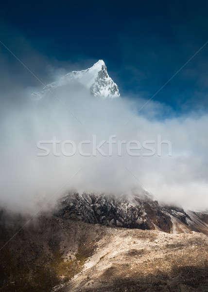 Verborgen wolken himalayas landschap sneeuw Stockfoto © Arsgera