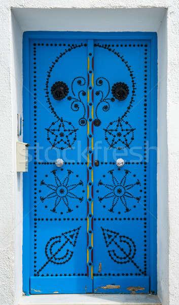 Traditional blue door from Sidi Bou Said in Tunisia Stock photo © Arsgera