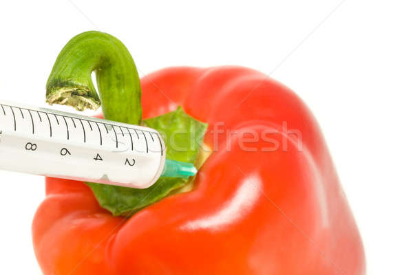 Genetically modified products - pepper and syringe Stock photo © Arsgera