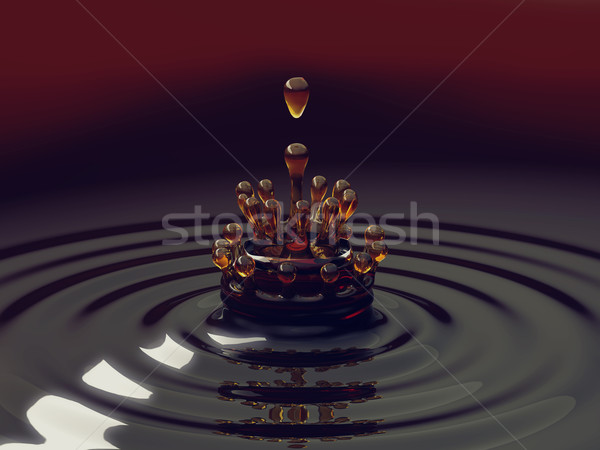 Splash of colorful liquid with droplets Stock photo © Arsgera