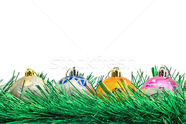 Four Beautiful Christmas decoration balls and green tinsel  Stock photo © Arsgera