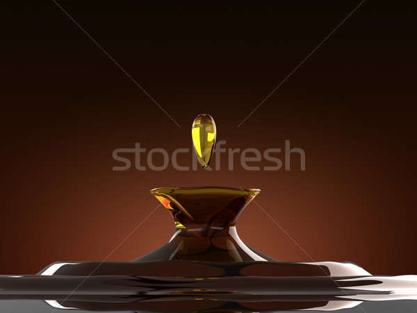 Alcoholic drink splash with droplet: cognac or whiskey Stock photo © Arsgera