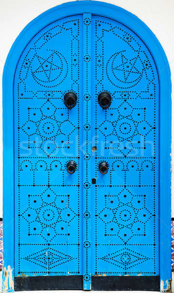 Traditional blue arched door from Sidi Bou Said in Tunisia Stock photo © Arsgera