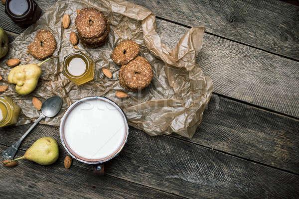 Tasty Pears almonds Cookies and joghurt on rustic wood Stock photo © Arsgera