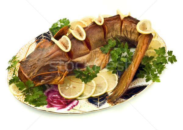 Bloated sheatfish with lemon and parsley Stock photo © Arsgera