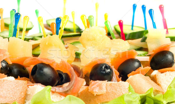 Close-up of canape with olives, cheese and mushrooms Stock photo © Arsgera