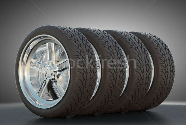 Group of four automotive wheels with studio light Stock photo © Arsgera