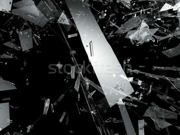 Damaged or broken glass on black Stock photo © Arsgera