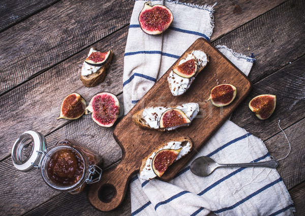 Bruschetta snacks with cut figs on napkin in rustic style Stock photo © Arsgera