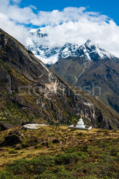 Buddhist stupe or chorten and summits in Himalayas Stock photo © Arsgera
