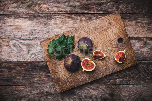 Tasty Figs on chopping board and wooden table Stock photo © Arsgera