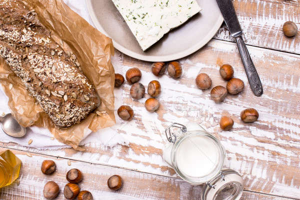 Tasty Bread with seeds huzelnuts and cheese on board Stock photo © Arsgera