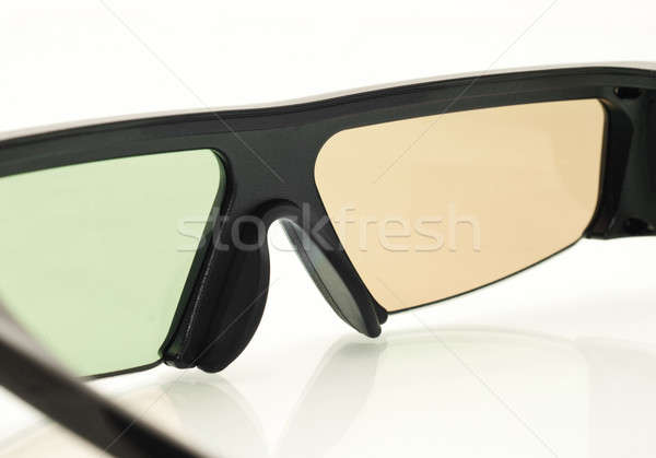 Stereo 3D TV: close up of active shutter glasses Stock photo © Arsgera