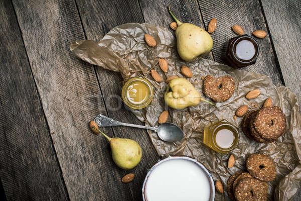 Pears nuts Cookies and joghurt on rustic wood Stock photo © Arsgera