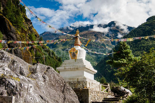 Buddhism: stupe or chorten with prayer flags in Himalayas Stock photo © Arsgera