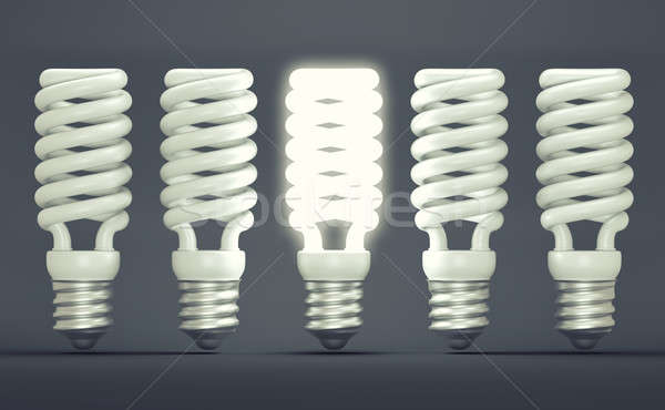 Idea or invention: illuminated efficient bulb among group of off Stock photo © Arsgera