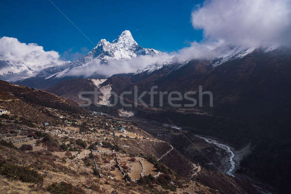 Ama Dablam summit or peak and Nepalese village in Himalayas Stock photo © Arsgera