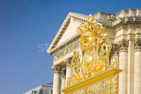 Golden crown over the gate and Palace in Versailles Stock photo © Arsgera