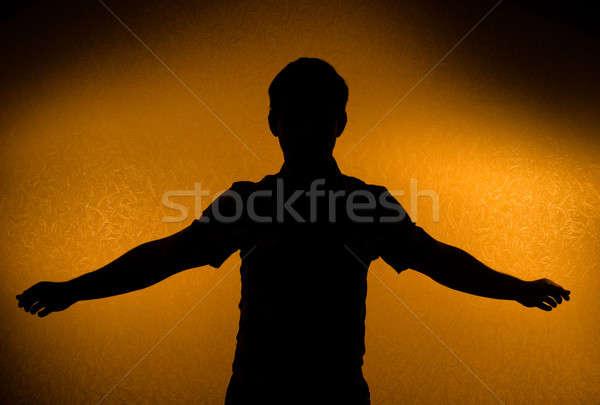 áttörés férfi sziluett kinyitott karok hát Stock fotó © Arsgera
