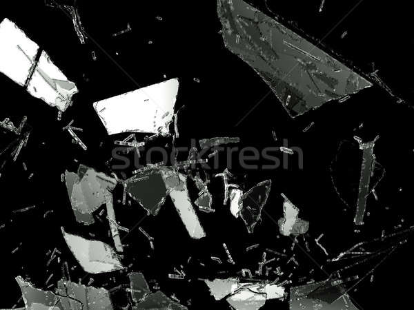 Shattered glass pieces on black background Stock photo © Arsgera