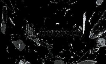 Shattered and splitted glass Pieces over black Stock photo © Arsgera