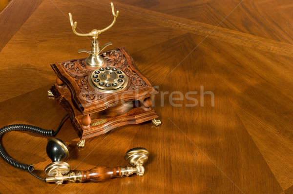Picked up phone. Old-fashioned telephone Stock photo © Arsgera