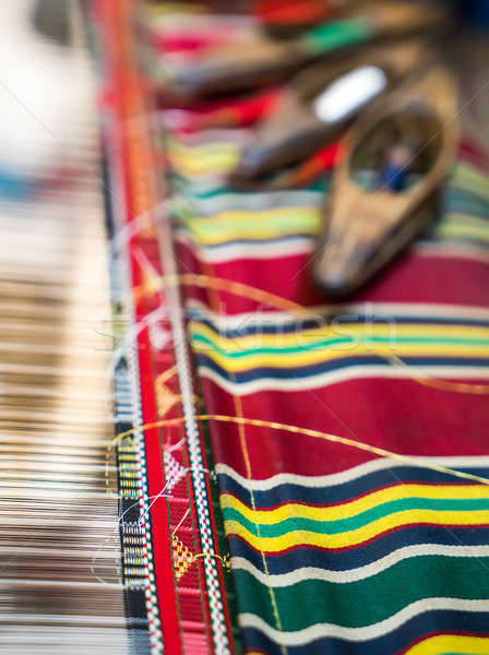Weaving shuttles and textured textile with pattern Stock photo © Arsgera