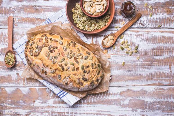 Nouvellement pain citrouille semences table en bois rustique Photo stock © Arsgera