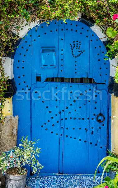 Velho azul porta arco parede rua Foto stock © Arsgera