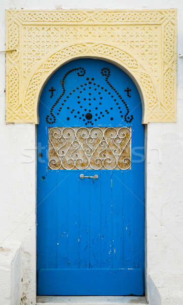 Blue door with ornament and arch from Sidi Bou Said in Tunisia Stock photo © Arsgera