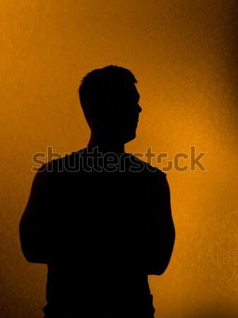 Gondolkodik valami sziluett férfi sötétség kezek Stock fotó © Arsgera