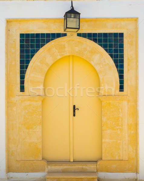 Yellow door with ornament and lantern from Sidi Bou Said Stock photo © Arsgera
