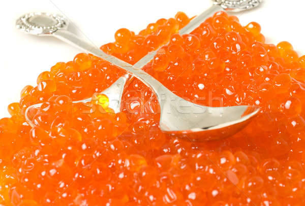 Delicatessen. Red caviar and silver spoons  Stock photo © Arsgera