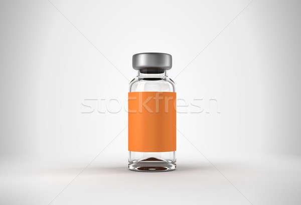 Single medical ampoule over grey Stock photo © Arsgera