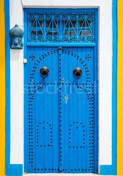 Tradicional azul puerta ornamento pared calle Foto stock © Arsgera