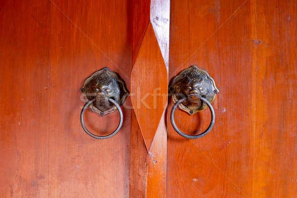 Old chinese door with lion's head door handles Stock photo © art9858