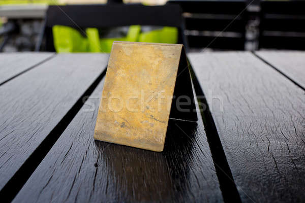Blank old brown leather table card on wood table. Stock photo © art9858