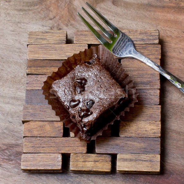 Pieces of chocolate brownie on a wooden with fork Stock photo © art9858