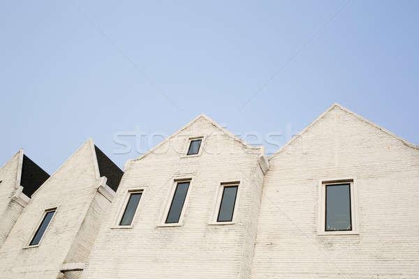 White cement brick block wall with a narrow window Stock photo © art9858