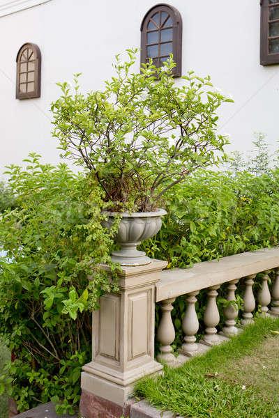 ceramic flowerpots on banister Stock photo © art9858