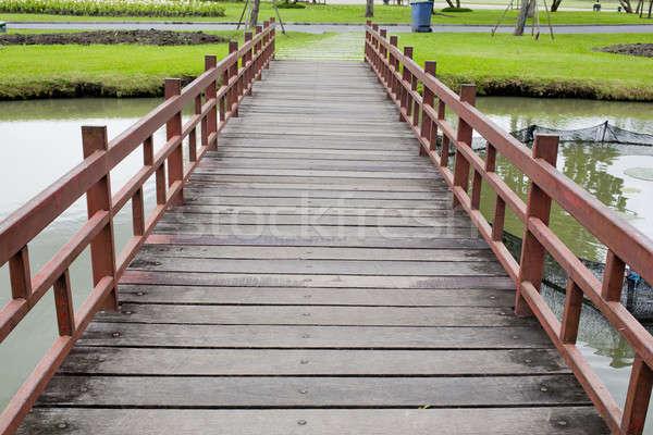 Wood bridge in park Stock photo © art9858