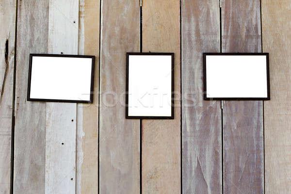 three blank frame on wood wall Stock photo © art9858