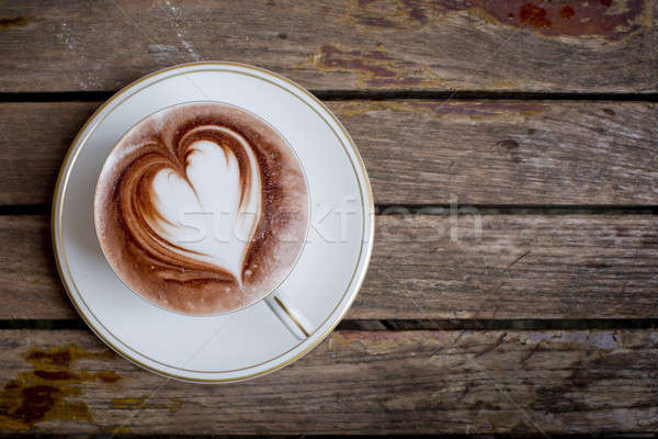 Cup of coffee on a wooden table Stock photo © art9858