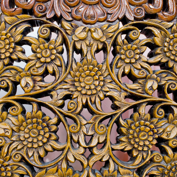 Pattern of flower carved on wood background Stock photo © art9858