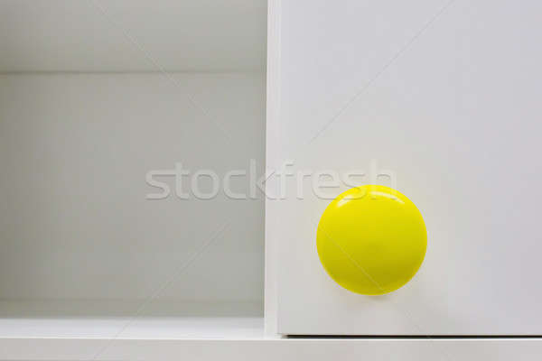 Cupboard handle with yellow color Stock photo © art9858