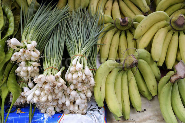 freshly harvested spring onions and bunch banana ready to sell a Stock photo © art9858